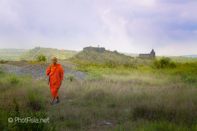 Monk wandering Bokor Hill Station, Cambodia
