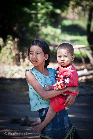 Sister & brother with traditional Thanakha face paint, Thayekhittaya, Myanmar